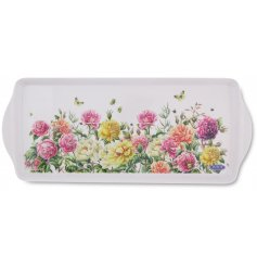 A rectangular serving tray beautifully decorated with a floral garden print