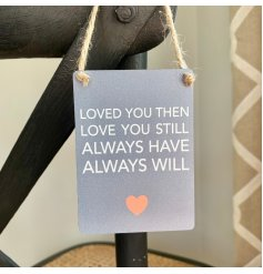 A hanging mini metal sign with a neutral grey base colour and block text decal