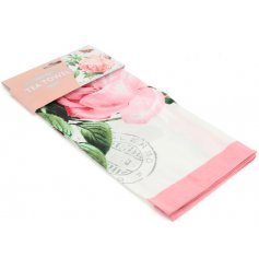 A soft fabric tea towel featuring a charming rose printed decal