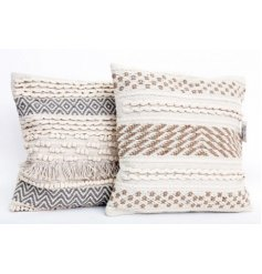 A mix of soft plump cushions, assorted by their woven decals and colours