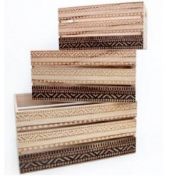 An assorted sized set of natural wooden storage crates, each featuring a beautiful African inspired trim