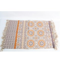this trending toned floor rug with added tasseled trimmings will be sure to place perfectly in any themed space