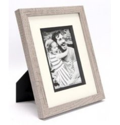 A sleek and simple natural wooden picture frame complete with an added white boarder and greywash theme