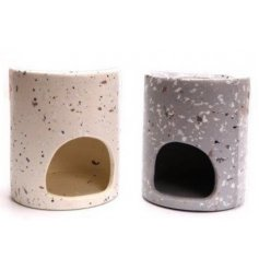 A mix of 2 round oil burners set with a terrazzo inspired decal