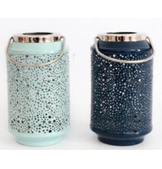 An assortment of tall standing metal lanterns featuring bubble inspired ridges and blue base tones