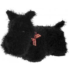 A fuzzy black Scottie Dog Doorstop, complete with a decorative tartan bow collar