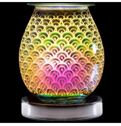 A stunning curved lamp with oil burner/wax melt feature. The lamp creates an attractive, 3D colour pattern