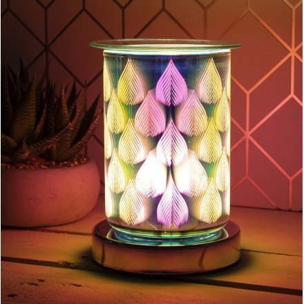 An attractive melt and oil burner lamp with a striking colour flame design.
