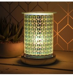 A unique and beautiful lamp with oil burner/wax melt feature. The lamp creates an attractive, geometric starburst effect