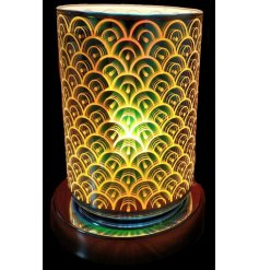 A unique and beautiful lamp with oil burner/wax melt feature. The lamp creates an attractive, 3D colour effect