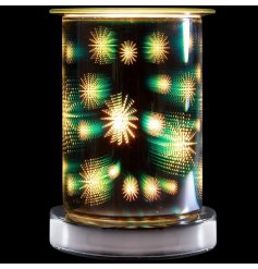An attractive melt and oil burner lamp with a striking 3D colour starburst design.