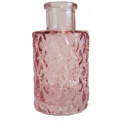 A small sized glass bottle set in a pretty pink tone and complimented by a diamond ridged decal