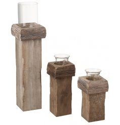 A charmingly rustic set of assorted sized candle holders