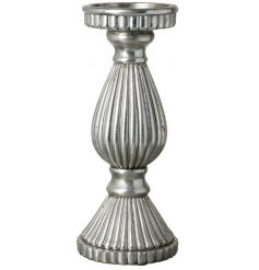 A large decorative Candle Holder set with a ribbed decal and distressed silver tone