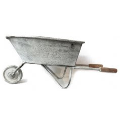 Bring this delightfully rustic wheelbarrow to any garden space for an added charm to the surround