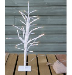 Bring a beautifully warm glow to any home interior with this charmingly simple standing twig tree