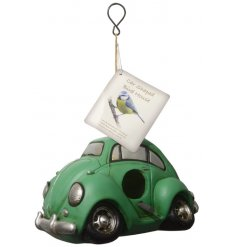 A charming little hanging birdhouse in the shape of a Green Beetle Car .