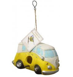 A charming little hanging birdhouse in the shape of a Yellow Camper Van
