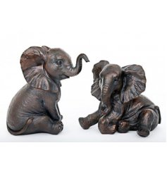 A charming mix of decorative Elephant Ornaments each set with its own sitting pose