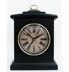 A stylishly simple black toned table clock featuring a round vintage face and added gold trimmings
