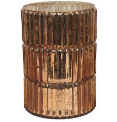 A beautifully distressed mottled glass hurricane candle holder featuring a ridged edging and bronze tone