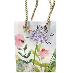A shall little gift bag beautifully decorated with a Botanical Garden inspired decal