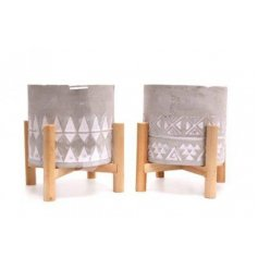 A mix of rustic inspired concrete planter pots, set ontop natural wooden legs and embossed with patterned decals