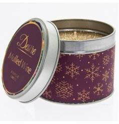 A festive themed Purple and Gold Tin filled with a delightfully fragrant wax centre