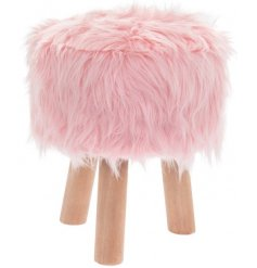 A fabulously fluffy faux fur stool set on top of 3 natural wooden legs
