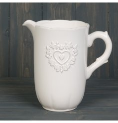 A Shabby Chic inspired ceramic jug featuring a pretty embossed heart decal