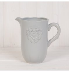 Set with a smooth grey ceramic glazing and added ridge heart decal