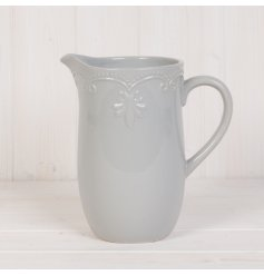 A charmingly simple ceramic jug set with a sleek grey tone and added inverted Fleur De Lis embossment