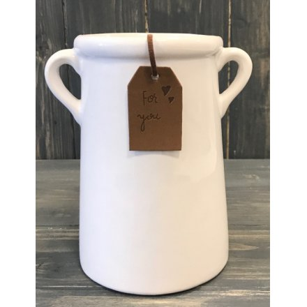A tall planter, ideal for displaying flowers and stems. Complete with a brown tag reading 'For You'.