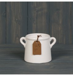 A chic small planter with a rich white glaze and twin handles. Complete with a brown PU leather gift tag
