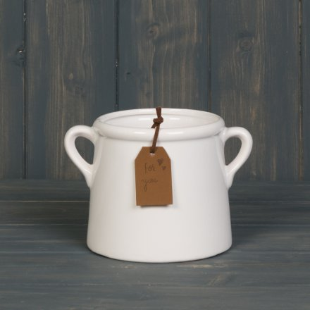A chic white planter with twin handles and a brown leather tag with an elegant 'For You' engraved slogan.