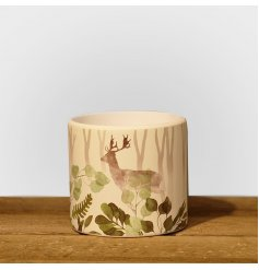 A chic woodland inspired planter with a stag design, trees and leaves. Created in a watercolour design.