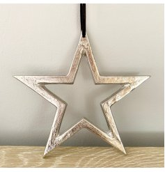 A chunky metal star shaped decoration with a textured silver nickel finish and long black hanger.