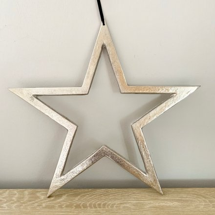 A chic and chunky metal star shaped decoration with a textured silver nickel finish and long black hanger.