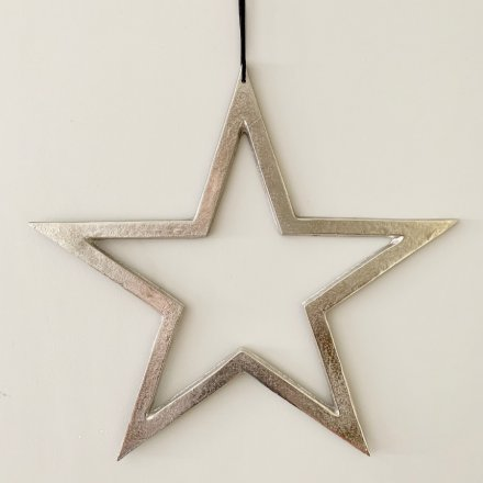 A stylish silver star decoration with a textured nickel finish and long black ribbon hanger.