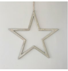 An extra large, chic silver star decoration with a raw nickel finish and long ribbon hanger in black.