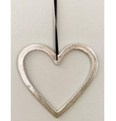 A chic silver hanging heart decoration with a distressed surface finish and black ribbon hanger.