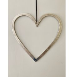 A rough luxe silver heart decoration with a textured nickel finish and long black ribbon hanger.
