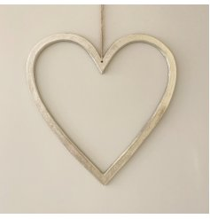 A stylish silver heart decoration with a distressed surface finish in nickel with a long black hanger.