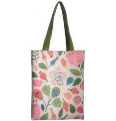 A large fabric tote bag featuring a beautifully printed autumnal decal