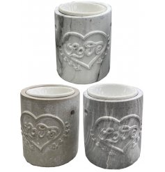 A sleek and stylish mix of concrete based candle holders with an embossed Love decal and removable oil/wax melt dish