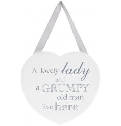 A smooth wooden heart plaque featuring a soft white tone and added grey scripted texts and ribbon hanger