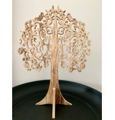 A wonderfully intricate rustic wooden tree decoration with carved leaves and a stand.