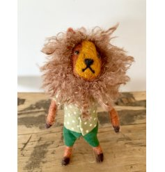 A unique and characterful felt lion figure with a large mane and polkadot shirt.