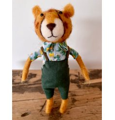 A charming and original felt leopard figure wearing a Hawaiian shirt and dungarees.