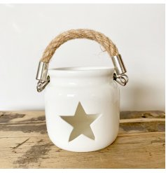 A chic lantern with a chunky rope handle and a stylish star cut out design.